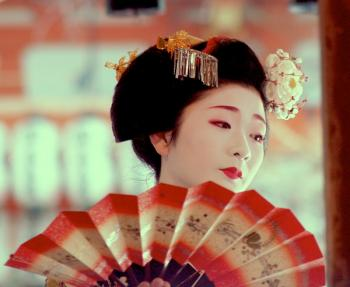 Geisha performing a fan dance