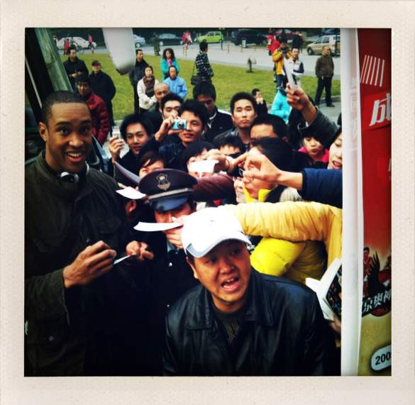 Signing autographs after a game in China