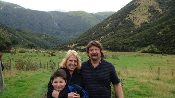 On a 4x tour in New Zealand with Orion and husband John. (Note sheep in background. Lots of sheep in NZ!)