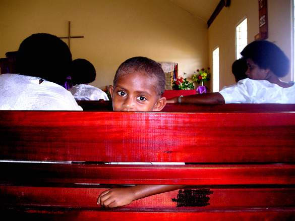 Girl in a church in Fiji