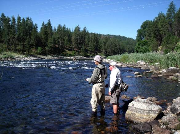 Roy Barnes gets fly fishing lessons from Stann Grater