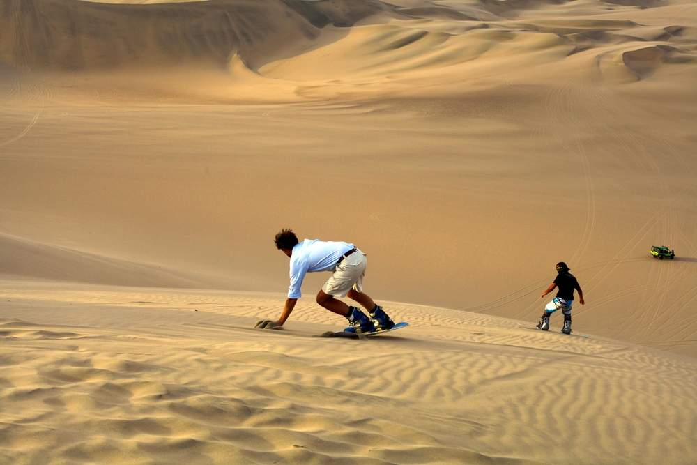 sand board in Peru snowboarding without the cold