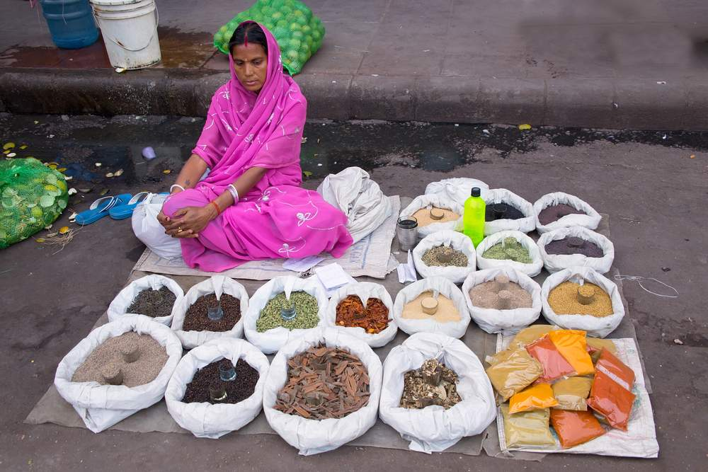 Woman selling spices on the street in New Delhi, India