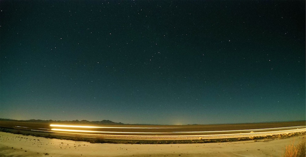 Train passing under my favorite constellation around 9pm in the desert